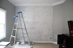 painted faux brick wall. I have always wanted an exposed brick wall in my house... Kitchen? Dining room?