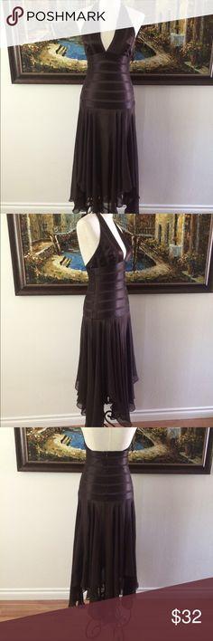 BCBGMAXAZRIA Silk Halter Gown BCBGMAXAZRIA rich brown 100% silk halter style dress, beautifully flowing and graceful gown, size 2. BCBGMaxAzria Dresses Asymmetrical