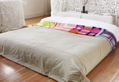 amazing re-use of designer silk scarves to make pretty blankets