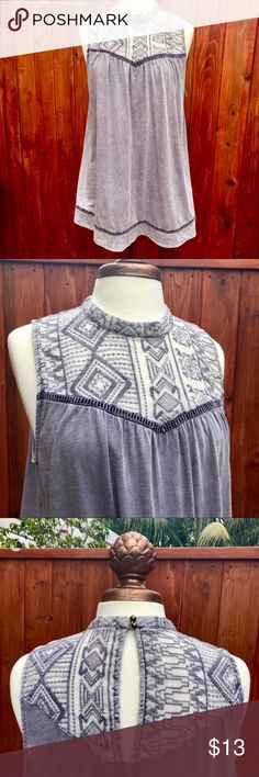 Lace bodice sleeveless halter neck Silvery grey blue halter neck tank top, with cool geometric mesh lace bodice and swing shape.  Two brass button closure at back of the neck.  Keyhole opening in back, and interesting detail at hems and above the bust.  Lots of room to breathe and move in this unique top.  BNWOT. Fire Los Angeles Tops Tank Tops