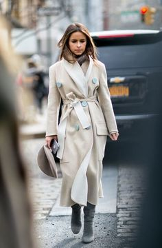Mira Duma wearing a classic trench coat.