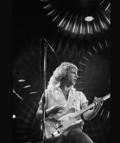 Rick Parfitt, guitarist with Status Quo, playing the guitar during a live concert performance by the band at Wembley Arena in 1979