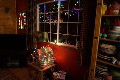 Fantástica IDEA para decorar la *N*av*i*d*ad!*: Poner una casita de madera, de tamaño no demasiado grande, que se puede tanto comprar cómo hacerla nosotros mismos y luego envolverla con luces de árbol de navidad <3 - by Linda L. Johnson   Flickr