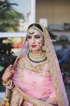 Stunning bubblegum pink lehenga with emerald green jewellery for the wedding day! Indian Bridal Fashion, Indian Bridal Makeup, Indian Bridal Wear, Indian Wedding Outfits, Bridal Outfits, Bridal Dresses, Indian Wear, Bride Indian, Sikh Bride
