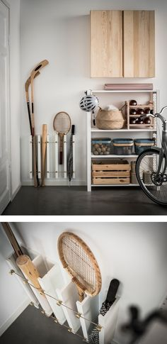 An IKEA MOSSLANDA hack using picture ledges secured vertically with tennis rackets, hockey sticks, baseball bats and umbrellas stored upright