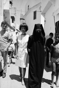 Author Jane Bowles and her friend Cherifa (wearing chador) walking the streets of Tangier. (Tanger).: (Photo by Terence/Time & Life Pictures/Getty Images)