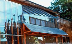 "Frank Gehry: Gehry House, west side overlooking enclosed yard with exposed 2""X 4"" studs of original building. Photo '86."