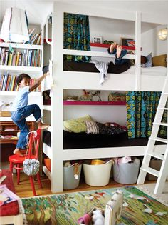 bunks with curtains, bins underneath, books on the wall