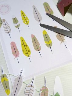 free printable paper feathers - great for a garland or for gift wrapping