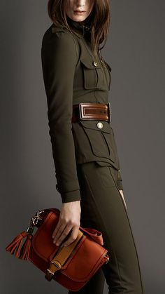 Burberry zip front epaulette jacket. Love the color red and green.