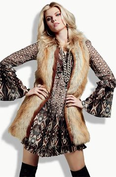 I kinda want this vest. It's hard to tell how good the faux fur looks unless in person though. (Not to mention the fact that I can't even afford faux fur! LOL)