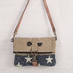 The Stardust Fold-Over Crossbody lends a patriotic flare to your wardrobe. It…