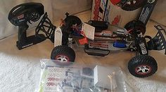 Price - $180.00. Traxxas Slash RTR 58034-1 Short Course 1/10 Truck W/QUICK CHARGER - MARK JENKINS ( Brand - Traxxas, Type - Trucks, MPN - TRA58034-1-25, Scale - 1:10, Fuel Type - Electric, Required Assembly - Ready to Go/RTR/RTF (All included), Color - Red, 4WD/2WD - 2WD, Motor Type - Brushed, Product Line - Slash    )