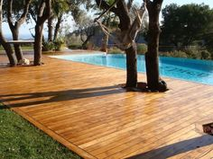 This above ground pool deck wraps all the way around the pool and has a custom gate. Description from deckpictures.org. I searched for this on bing.com/images