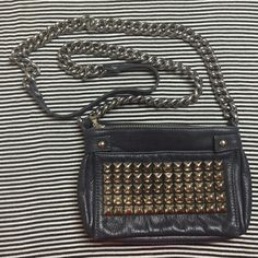 """Tylie Malibu Studded Purse Really soft navy blue leather purse. It has silver studs lining the front pocket. Chain straps that are in perfect shape. Chains are long enough to wear as a crossbody bag. This purse adds a punch of style to any outfit!   Measures 8""""wide 6"""" high Tylie Malibu Bags"""