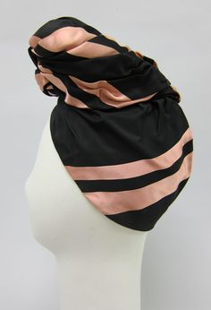 """Turban style hat of black and pink striped satin with stuffed stand up pleated pouf in front. Lined in black net with black grosgrain ribbon inner headband. New York"""" Turbans, Head Wrap Scarf, Turban Style, Vintage Couture, Grosgrain Ribbon, Head Wraps, Number 3, Stylish, Hats"""