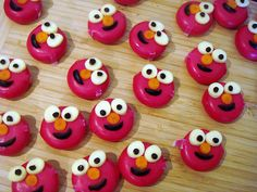 Babybell cheese Elmos! by LoveBones, via Flickr.  Babybell cheese, sliced string cheese for eyes, sliced baby carrot for nose, and halved olive slice and tiny bits for mouth and eyes.