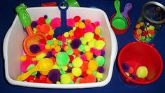 Pom Pom sensory tub, less mess! Shake it up with plastic/wooden letters to find, get a sequencing mat and sequence the pom poms you pull out, or chart and graph!    childcareland.com - Early Learning Activities For Pre-K and Kindergarten