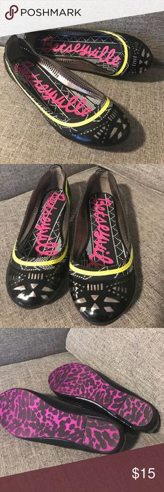 Betsey Johnson - Flats Betsey Johnson - Betseyville Flats. Black flats with yellow linings and silver decor details. Inside signature betseyville trademark, sole of shoe is purple leopard. Betsey Johnson Shoes Flats & Loafers