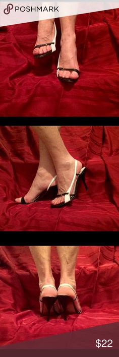 """⌛️👠Vintage bebe Black & White Slingbacks Sexy slender strapped slingbacks in black & white leather from bebe. These girly shoes feature decorative buckles at the toe and a black 4"""" stiletto heel. One heel has some scratches that have been covered. They are not noticeable unless held at a certain angle in bright light but I have tried to show them. They in no way detract from these beautiful iconic shoes, but they are there and price will reflect this. Leather sole with light wear. Size 6.5…"""
