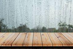 wood table with rain water drop on window