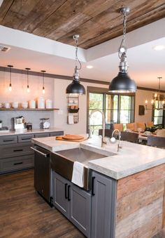 Kitchen with wood floors/ceilings painted cabs