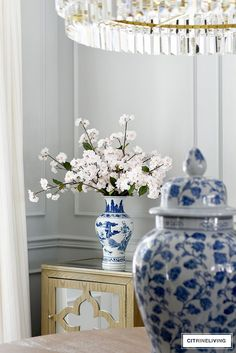 Pair beautiful faux blossoms with blue and white chinoiserie for a soft and pretty spring look. #springdecorating #decoratingideas #openconcepthome #diningroomideas #springdecor #blueandwhite