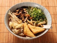 Dried mushrooms are the secret to this intensely-flavored mushroom-soy broth that is 100% vegan. Serve it with udon noodles topped with with stir-fried mushrooms and cabbage, scallions, and fried tofu.