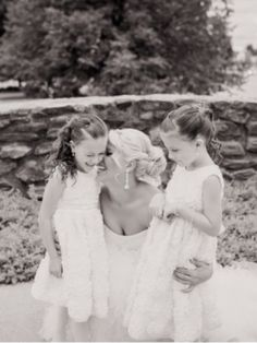 Wedding photo idea. Bride with flower girls.. sooo cute! Pretty sure if I ever got this close to Addie's neck she would hit me with her basket though!