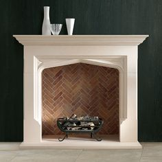 Herringbone brick tiled fireplace. hmmm...wonder what the same tile would look like for a kitchen backsplash