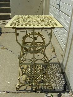 Upcycled Antique Sewing Machine Base with Cast Iron Register Grate Top.
