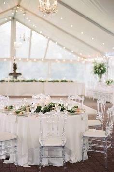 """From the editorial """"It Rained, Then It Rainbowed: Check Out This European Inspired Wedding at Oxon Hill Manor."""" On SMP, we're sharing how this whole bride's family came together to bring her tented reception space to life! The details will melt your heart!  Photography: @dusoleilphoto  #tentreception #weddingreceptioninspo #weddingreceptionlights #weddingreceptionlayout"""