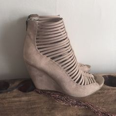 Bakers Wedge open toe bootie Hot!! Worn these twice, very minor imperfections. Absolutely perfect shade of beige. Very comfortable. Wedge is about 3.5-4 inches but you'll feel like you're wearing flats. Bakers Shoes Wedges