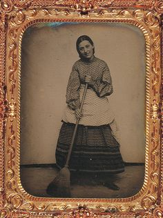 Portrait of a woman with broom, George Eastman House
