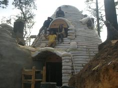 Superadobe to 8' 1st level w barn free entrance to East, 2nd level ground loading wagon loose hay loft w roof track system, on farm road to East.