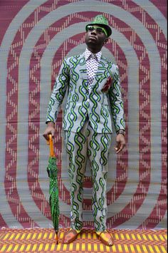 Rapper African Boy wearing Babatunde Trilby with matching umbrella from SOBOYE.  PH: Hassan Hajjij