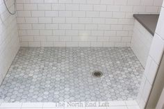 this is what the master and guest bathroom will look like! The shower floor is hexagon-shaped marble tiles with darker gray grout. We had the marble sealed and upgraded all the grout to one that resists mold and fading. Marble Bathroom, Shower Floor, Shower Tile, Bathroom Redo, Bathroom Makeover, Shower Floor Tile, White Subway Tile Shower, Mold In Bathroom, Bathroom