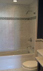 Glass shower screens are a great alternative to a boring shower rod and curtain.