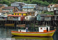 Fishermen's traditional wood houses (palafitos) rise on stilts in Castro on Chiloé Island, Columbia South America, South America Map, Best Hotel Deals, Best Hotels, Sur Chile, Backpacking South America, America Memes, House On Stilts, Fishing Villages