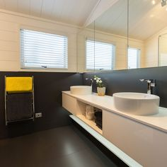 Upper walls and a ceiling in Resene Quarter Merino contrast with charcoal tiles in the bathroom. Home Design Plans, Plan Design, Aluminium Joinery, Timber Walls, Acoustic Panels, Black Kitchens, Home Renovation, House Plans, Kiwi