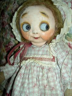 """Circa 1911-14, with huge,GOOGLY blue glass eyes, distributed by George Borgfeldt & Co. Thisextremely rare and unusual, teddy bear-style doll is all original and in. """"googly eyes"""". Her original, pink cloth body is hair stuffed with metal joints at her shoulders and hips with shaped feet. 