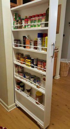 Slide away pantry. Beside fridge