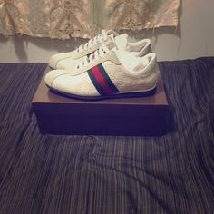Classic white and Gucci stripe sneakers White leather and suede with classic green and red gucci stripes on side. Comes with brand new white shoelaces and duster bags. Size 39. Top suede has small signs of wear. Gucci Shoes Sneakers