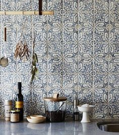Kitchen with blue and white tiles from Rita Konig's Instagram.
