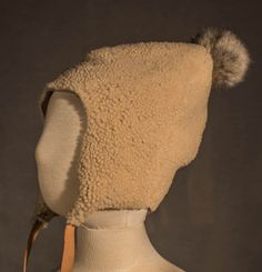 Creme Sheepskin fur infant hat. Gray Rabbit fur puff detail. Vegetable tanned leather ties