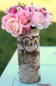 birch tree trunk vase with initials carved for table decor... Too cute!