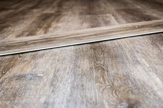 """Are you looking to remodel your house? Are you searching for the best flooring option? We've got you covered! We understand that it can be confusing seeing various acronyms for floors that don't make much sense to the average consumer.  If you've recently come across """"SPC Flooring"""" labels, it means Stone Plastic Composite Flooring. Visit our blog to learn more! #SPC #SPCflooring #kitchenflooring #kitchenfloor #bathroomflooring #bathroomfloor #spcvinylflooring #spcflooringlivingroom Most Durable Flooring, Best Flooring, Flooring Options, Vinyl Flooring, Bathroom Flooring, Kitchen Flooring, Lily Ann Cabinets, Composite Flooring, Beige Living Rooms"""
