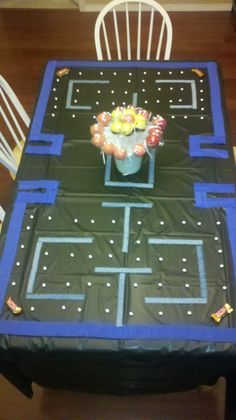 PacMan themed birthday table! Sixlets, Twix, Raspberry Sour Strips and Cake Pops make it edible! :-)