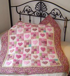 Traditional Amish design incorporating nine-patches and appliqued hearts - in pink for a little girl  (Original Design)