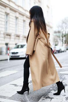 Shop this look on Lookastic:  http://lookastic.com/women/looks/camel-coat-black-skinny-jeans-black-suede-ankle-boots/8333  — Camel Coat  — Black Skinny Jeans  — Black Suede Ankle Boots